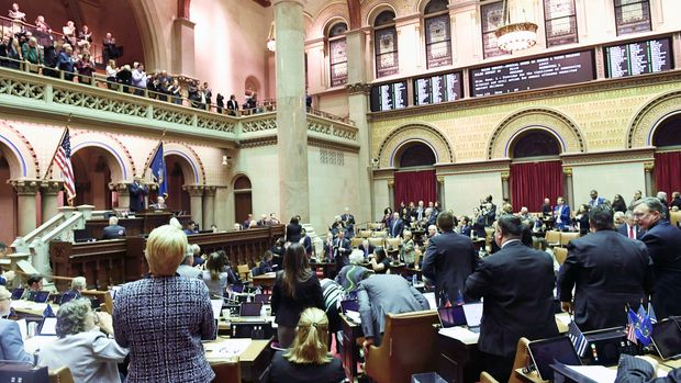 Members of the New York Assembly celebrate after the Child Victims Act passed in the Assembly Chamber at the state Capitol on Monday, Jan. 28, 2019, in Albany, N.Y. (AP Photo/Hans Pennink)