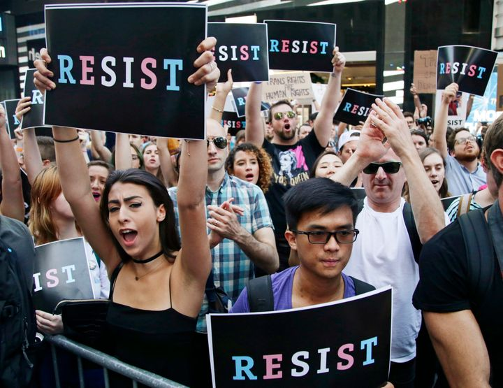 Demonstrators rally in New York's Times Square on July 26, 2017, to protest Trump's announcement of a ban on transgender troo
