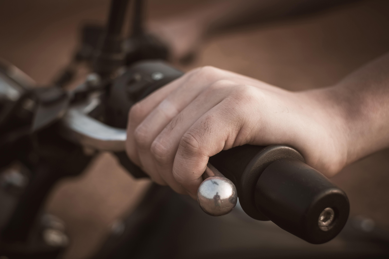 Human hand on the motorbike handlebar