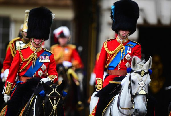 Prince Charles pictured with Prince William, both on horseback, during the ceremony.