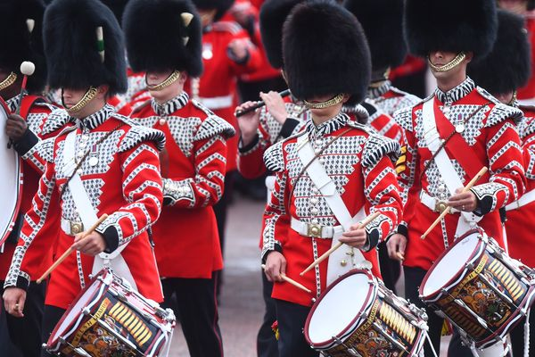 Soldiers march to Horse Guards Parade in London with their rifles in hand, ahead of the Trooping the Colour ceremony.