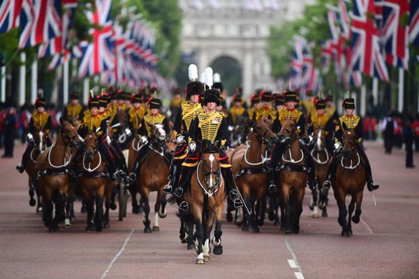 Soldiers take part in the parade along the Mall in London, after the Trooping the Colour ceremony.