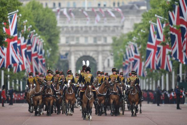 Members of the King's Troop Royal Artillery lead the parade down the Mall back to Buckingham Palace after the queen's birthda