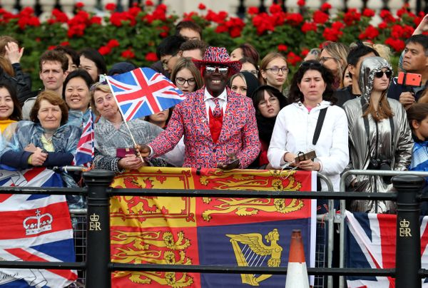 Well-wishers pictured ahead of the Trooping the Colour ceremony.