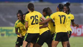 Jamaica's team celebrates after Khadija Shaw (2nd L) scored a goal during the friendly match between Jamaica and Panama at the National Stadium in Kingston, Jamaica on May 19, 2019. - They don't have tons of money, sponsors or flashy practice facilities but they didn't let that stop them: Jamaica's 'Reggae Girlz', the women's national football team that did not even exist a few years ago, are heading to France to battle for the World Cup. (Photo by Angela Weiss / AFP)        (Photo credit should read ANGELA WEISS/AFP/Getty Images)
