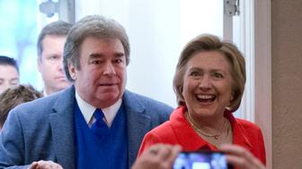 In this April 22, 2016, photo, Democratic presidential candidate Hillary Clinton arrives at Casa Bella restaurant accompanied by her brothers Tony Rodham, left, and Hugh Rodham in Scranton, Pa. Everywhere Clinton goes lately, it seems, amounts to a homecoming of sorts. (AP Photo/Matt Rourke)