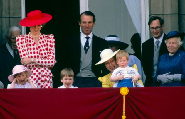 Princess Anne holding Prince Harry after Trooping The Colour in