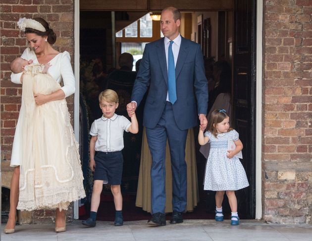 Kate Middleton, Duchess of Cambridge, holds a newly christened Prince Louis on June 20,