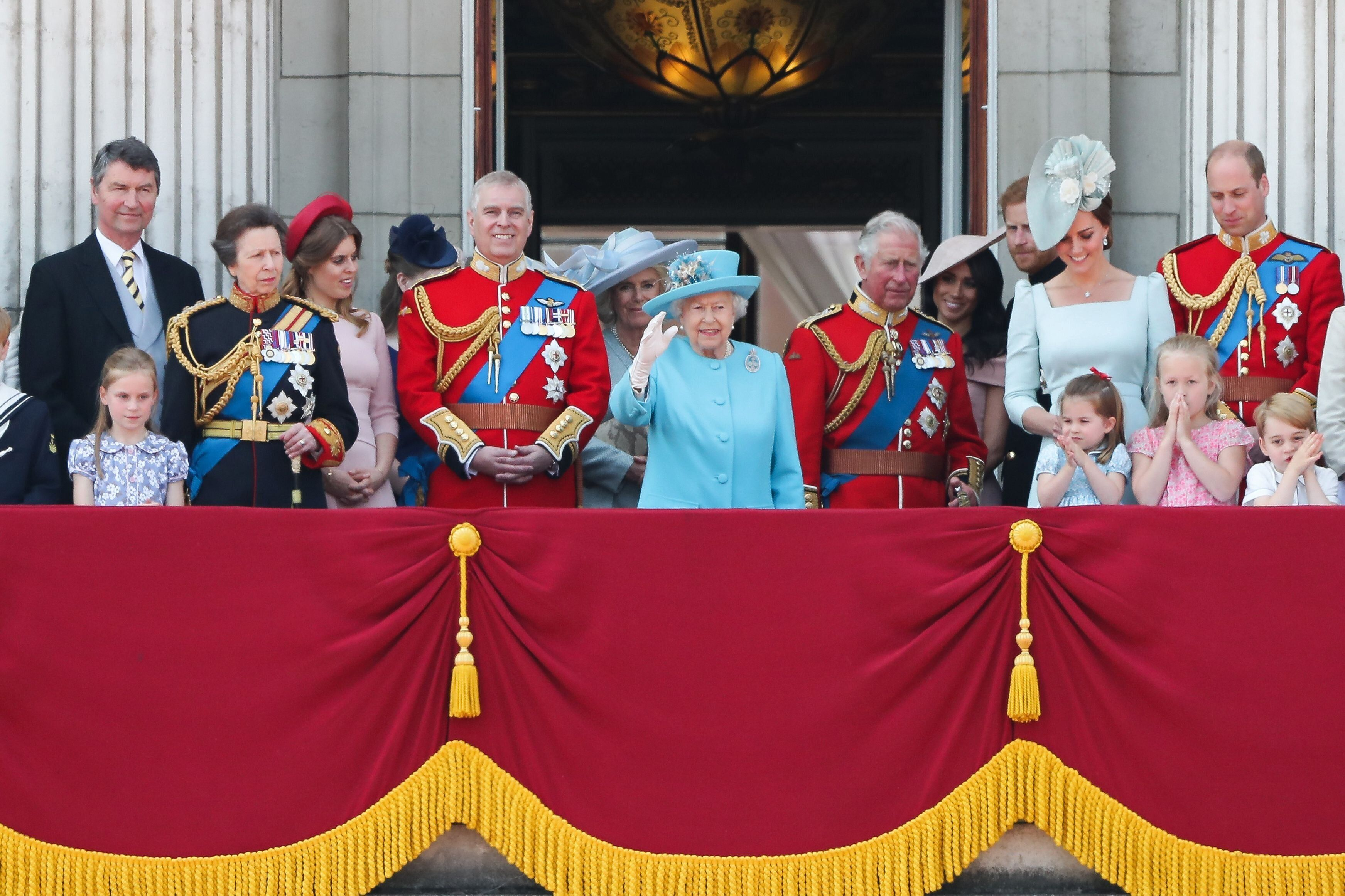 Prince Harry and Meghan Markle pictured standing at the back at the 2018 Trooping the Colour balcony, while Prince Andrew stands next to the Queen