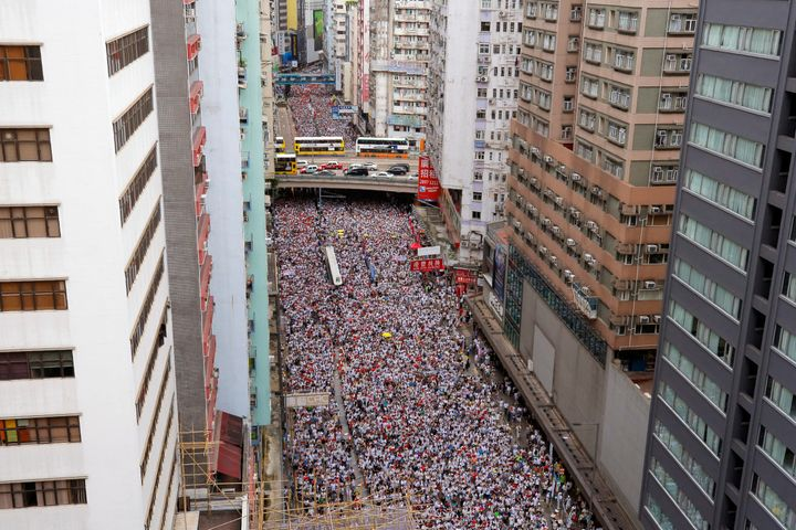 Thousands of protesters march in a rally against the proposed amendments to extradition law in Hong Kong, Sunday, June 9, 201