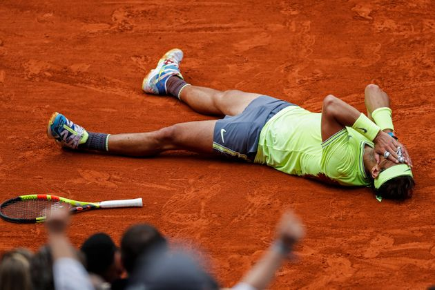 Spain's Rafael Nadal celebrates his record 12th French Open tennis tournament title after winning his...