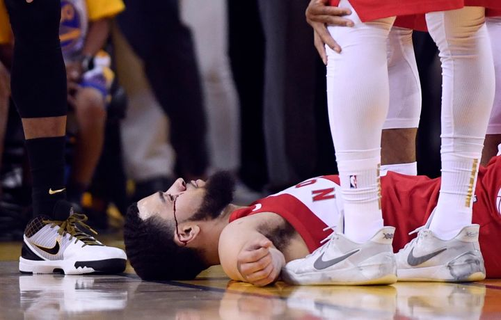 Fred VanVleet lays on the floor as blood flows from below his eye during the second half of Game 4 against the Golden State Warriors in Oakland, Calif. on Friday.