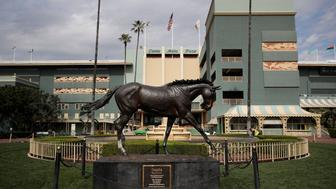 FILE - In this March 5, 2019, file photo, a statue of Zenyatta stands in the paddock gardens area at Santa Anita Park in Arcadia, Calif. California Gov. Gavin Newsom is supporting a state Senate bill that would give the California Horse Racing Board authority to quickly suspend a meet license to protect the health and safety of horses or riders. The announcement Thursday, May 30, 2019, comes amid deaths of 26 horses at Santa Anita since Dec. 26. (AP Photo/Jae C. Hong, File)