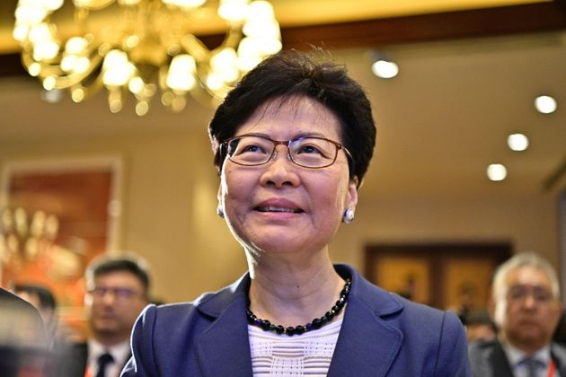 Hong Kong Chief Executive Carrie Lam smiles as she arrives before speaking at the Caixin Summit in Hong...