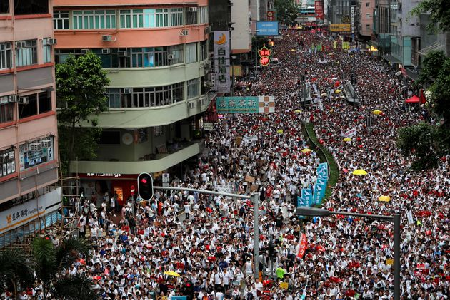 Demonstrators attend a protest to demand authorities scrap a proposed extradition bill with China, in...