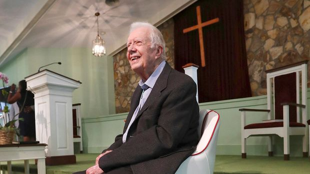 President Jimmy Carter, 94, returns to Maranatha Baptist Church to teach Sunday School less than a month after falling and breaking his hip on Sunday, June 9, 2019, in Plains, Ga. A member of the congregation made a special chair for the former president out of a boat seat. (Curtis Compton/Atlanta Journal-Constitution via AP)