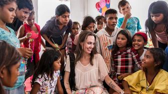 MAICO, COLOMBIA - JUNE 08:  (EDITORIAL USE ONLY) In this handout image provided by United Nations High Commission for Refugees, UNHCR Special Envoy Angelina Jolie meets with children who fled Venezuela, at the Integrated Assistance Centre on June 8, 2019 in Maicao, Colombia. The Integrated Assistance Centre provides integrated assistance to Venezuelan refugees and migrants, Colombian returnees and Wayuu population, identified as the most vulnerable, by improving access to legal assistance, psychosocial support, health, food, shelter and care. Due to the high numbers of people fleeing Venezuela those staying at the centre, including these children, can stay no longer than 30 days. (Photo by Andrew McConnell/UNHCR via Getty Images)