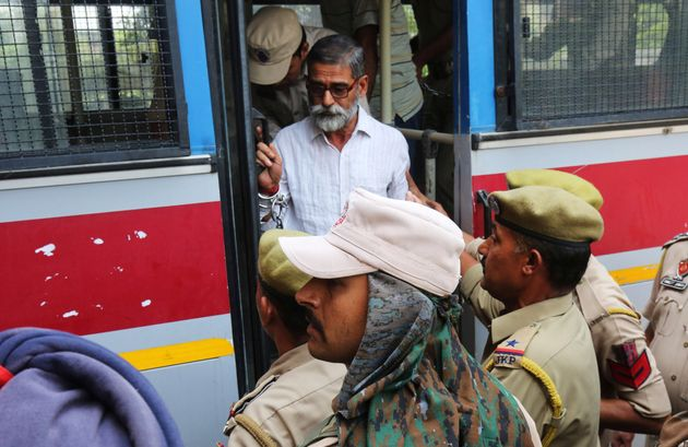 Sanji Ram, one of the seven accused in the rape and murder of an eight-year-old girl in Kathua, arrives...