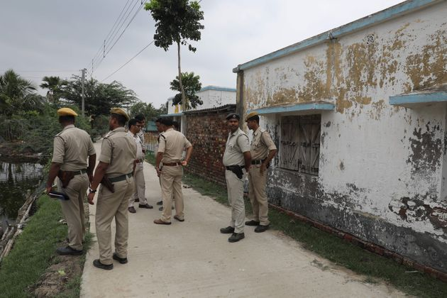 Police stand guard at the scene of the gun battle in Sandeshkhali in West