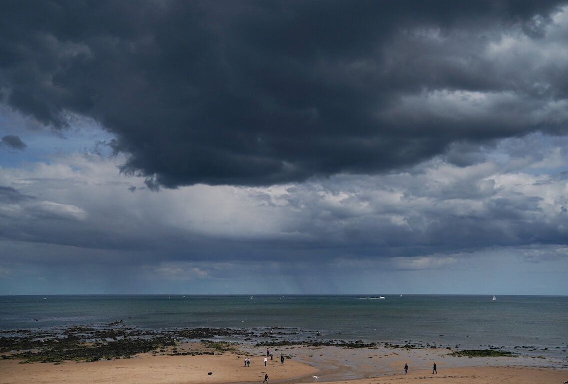 Rain clouds over Whitley Bay beach in Northumberland (Picture: PA)
