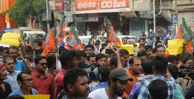 BJP workers take out a protest rally in