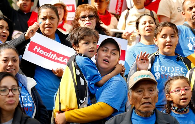 Oralia Sandoval, center, holds her son Benjamin, 6, as she participates in an Immigrants Day of Action...
