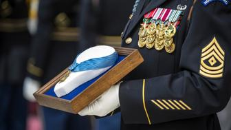 September 22, 2013 - U.S. Army Sergeant holds the Medal of Honor during an Enshrinement Ceremony at the Smithsonian National Postal Museum in Washington, D.C.