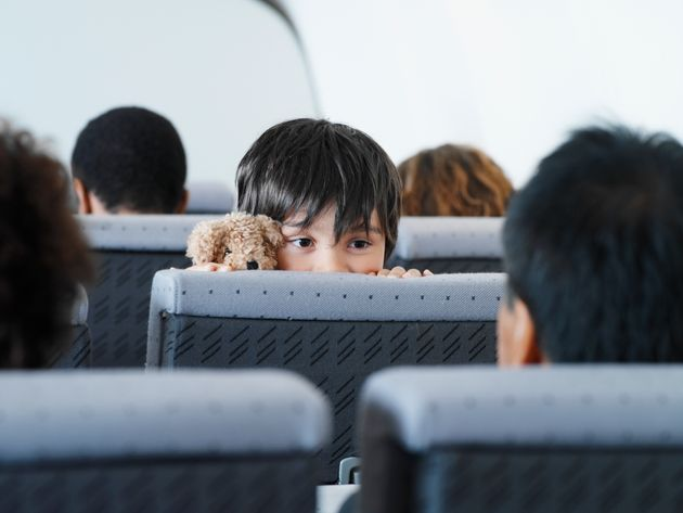 Air Canada's policy is to sit young children together with a parent or guardian at no additional