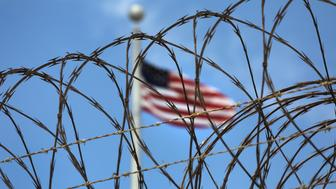 "GUANTANAMO BAY, CUBA - OCTOBER 23:  (EDITORS NOTE: Image has been reviewed by the U.S. Military prior to transmission.) Razor wire tops the fence of the U.S. prison at Guantanamo Bay, also known as ""Gitmo"" on October 23, 2016 at the U.S. Naval Station at Guantanamo Bay, Cuba. The U.S. military's Joint Task Force Guantanamo is still holding 60 detainees at the prison, down from a previous total of 780. In 2008 President Obama issued an executive order to close the prison, which has failed because of political opposition in the U.S.  (Photo by John Moore/Getty Images)"