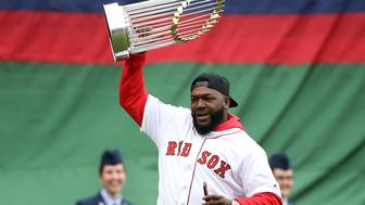 BOSTON MA. - APRIL 9:  Former Red Sox player David Ortiz carries a World Series trophy onto the field during pregame ceremonies prior to Boston's home opener against the Toronto Blue Jays at Fenway Park on April 9, 2019 in Boston, Massachusetts. (Staff Photo By Nancy Lane/MediaNews Group/Boston Herald via Getty Images)