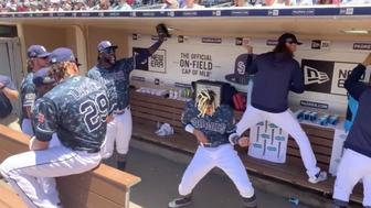 "Members of the San Diego Padres jam out to ""All Star"" in the team dugout."