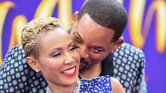 TOPSHOT - US actor Will Smith and his wife actress Jada Pinkett Smith attend the World Premiere of Disneys Aladdin at El Capitan theatre on May 21, 2019 in Hollywood. (Photo by VALERIE MACON / AFP)        (Photo credit should read VALERIE MACON/AFP/Getty Images)