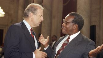 Supreme Court Justice Clarence Thomas gestures while talking with Sen. Joseph Biden, D-Del., chairman of the Senate Judiciary Committee, during a break in the committee?s nomination hearing for Thomas on Capitol Hill in Washington, Friday, Sept. 13, 1991. (AP Photo/John Duricka)