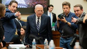 Former White House counsel John Dean is directed to his seat as he arrives for a House Judiciary Committee hearing on the Mueller Report, Monday, June 10, 2019. (AP Photo/Manuel Balce Ceneta)