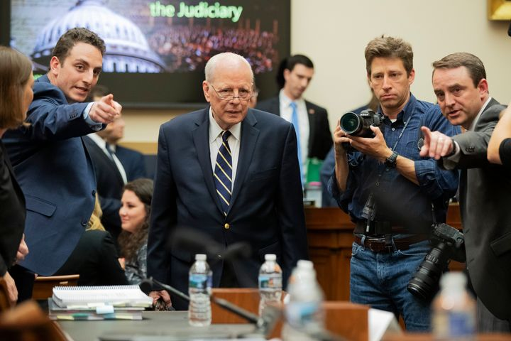 Former White House counsel John Dean is directed to his seat Monday as he arrives for a House Judiciary Committee hearing on