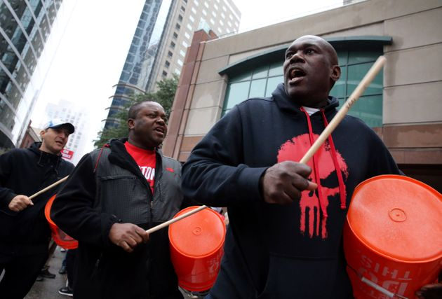 Workers and supporters picket outside the Sheraton Boston by Marriott in Boston on Oct. 3, 2018. The...
