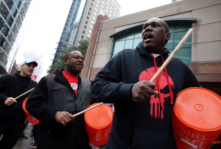 Workers and supporters picket outside the Sheraton Boston by Marriott in Boston on Oct. 3, 2018. The hotel was part of an 8-c