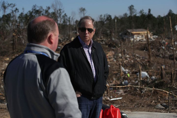 Jones visits one of the hardest hit areas by a tornado that touched down in March in Beauregard, Alabama.