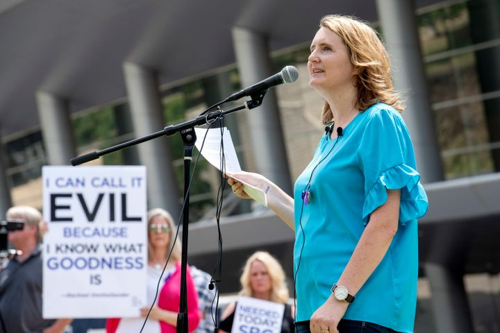 Mary DeMuth, a rape survivor who's an advocate for sexual abuse victims, speaks during a rally at the Southern Baptist Conven