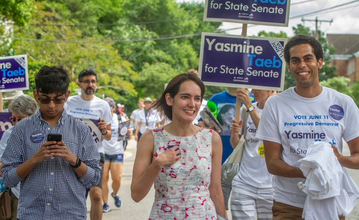 Yasmine Taeb, a human rights attorney challenging Dick Saslaw, talks to constituents in the Memorial Day Parade in Falls Chur