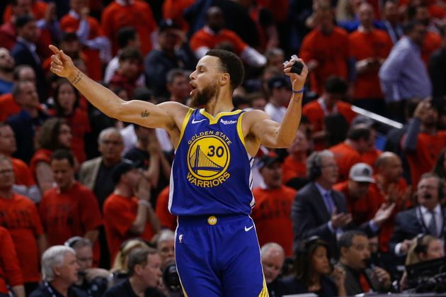 Golden State Warriors guard Stephen Curry celebrates the win at Scotiabank Arena on June 11,