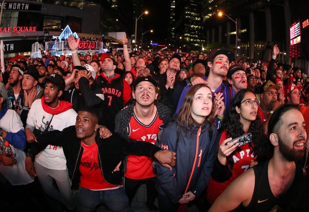 Fans watch the closing moments of the fourth quarter at Jurassic Park at Scotiabank Arena on June 10,...