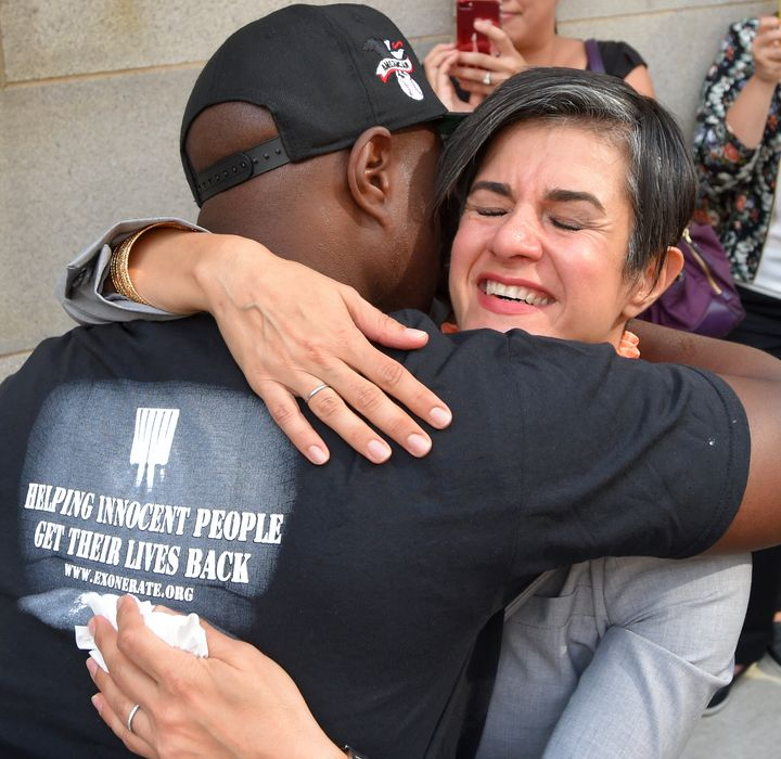 Parisa Dehghani-Tafti, legal director of the Mid-Atlantic Innocence Project, hugs Lamar Johnson, who was released after 13 ye