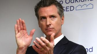 OAKLAND, CA - MAY 21: California Governor Gavin Newsom applauds during a press conference at the Henry Robinson Multi-Service Center in Oakland, Calif., on Tuesday, May 21, 2019. Newsom announced the formation of the Homeless & Supportive Housing Advisory Task Force and has pledged $1billion of the state budget to fight homelessness. (Photo by Jane Tyska/MediaNews Group/The Mercury News via Getty Images)