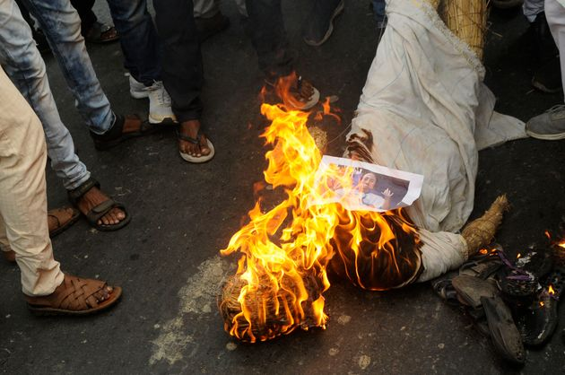 BJP workers burn an effigy of Chief Minister Mamata Banerjee in