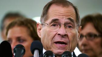"FILE - In this Sept. 28, 2018, file photo, House Judiciary Committee ranking member Jerry Nadler, D-N.Y., talks to media during a Senate Judiciary Committee hearing on Capitol Hill in Washington. Nadler, the top Democrat on the House Judiciary Committee says he believes it would be an ""impeachable offense"" if it's proven that President Donald Trump directed illegal hush-money payments to women during the 2016 campaign. But Nadler, who's expected to chair the panel in January, says it remains to be seen whether that crime alone would justify Congress launching impeachment proceedings. (AP Photo/Carolyn Kaster, File)"
