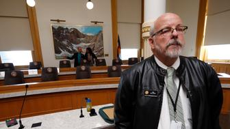 "Colorado Rep. Tom Sullivan, D-Aurora, who lost his son in the 2012 mass shooting at a movie theater in Aurora, waits to speak during a hearing before the House Judiciary Committee on a bill to get a ""red flag"" gun law on the books in Colorado Thursday, Feb. 21, 2019, in Denver. The bill, which is backed by several law enforcement officials, would allow for the seizure of weapons from persons deemed by a court to pose a significant risk to themselves and to others. (AP Photo/David Zalubowski)"