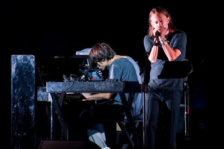 Thom Yorke and Jonny Greenwood (on piano) of the group Radiohead perform onstage on Aug. 20, 2017, in Macerata, Italy.