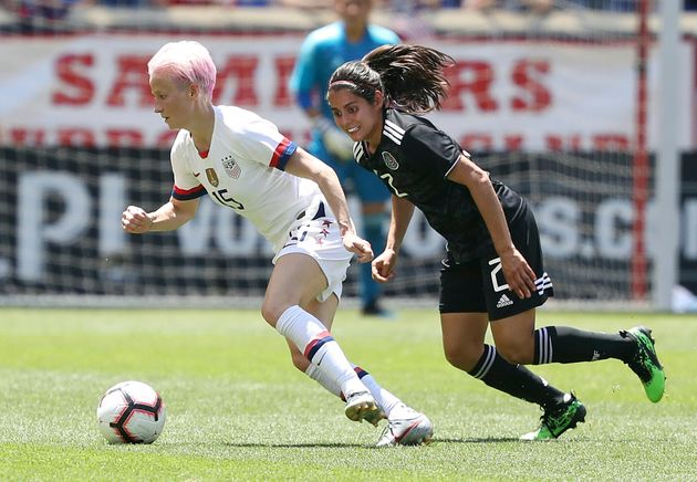Megan Rapinoe, a forward player on the U.S. women's national team, dribbles the ball away from Mexico...
