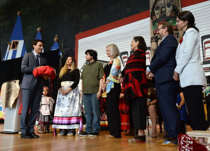 Prime Minister Justin Trudeau holds a copy of the National Inquiry into Missing and Murdered Indigenous Women and Girls final report at a ceremony in Gatineau, Que., on June 3, 2019.